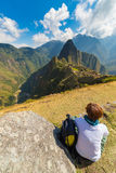 Tourist looking at Machu Picchu from above, Peru Royalty Free Stock Images