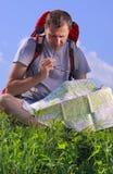 Tourist looking on map Stock Photo