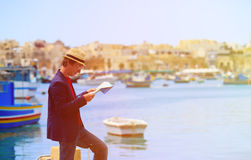 Tourist looking at map on the quay of Malta Royalty Free Stock Image