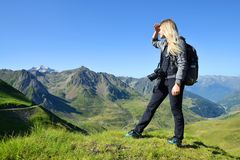 Tourist looking at the mountain landscape in the Pyrenees national park. stock images