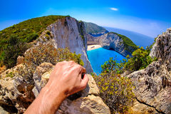 Tourist looking at Navagio Shipwreck panoramic scenic view Stock Photography