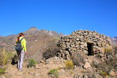 Tourist looking at pre-Incan round house named colca near Chivay Royalty Free Stock Photography