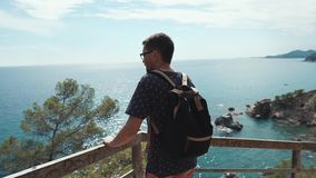Tourist looking at sea and mountains. stock footage