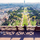 Tourist looking to the Champ de Mars on the observation deck of Stock Photo