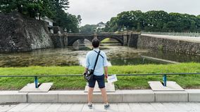 Tourist looking at Tokyo Imperial Palace and Seimon Ishibashi stone bridge of main gate, Japan stock images