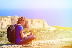Tourist looking at touch pad on mountains travel Royalty Free Stock Photography