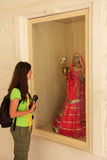 Tourist looking at traditional dress, Mehrangarh Fort museum, Jo Royalty Free Stock Photography