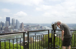 Tourist looking through viewfinder. At Pittsburgh city skyline stock photos