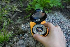 Tourist looking for a way with a compass. Orientation and travel concept. Space for text stock photography