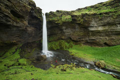 Tourist looks at the big waterfall in Iceland Royalty Free Stock Images