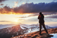 Tourist looks at the landscape. Beautiful sunset Stock Photography