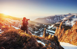 Tourist looks at the landscape. Beautiful sunset Royalty Free Stock Images