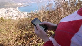The tourist looks at the map on the smartphone. A girl on the hi stock footage