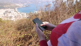 The tourist looks at the map on the smartphone. A girl on the hi stock video