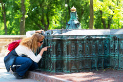 Tourist looks at a miniature copy of the Winter Palace Royalty Free Stock Image