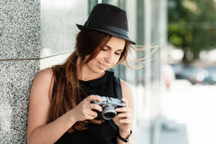 Tourist looks at the photos shot with the digital camera. Stock Image