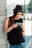 Tourist looks at the photos shot with the digital camera. Royalty Free Stock Images