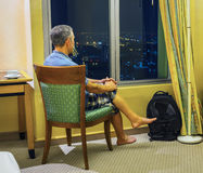 Tourist looks of the rooms at night Bangkok Stock Photography