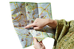 Tourist looks for a route on map isolated. Tourist looks for a route on the map isolated royalty free stock photo