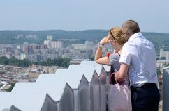 Tourist loving couple looking at modern part of Lviv city,ukraine Stock Photography