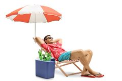 Tourist lying in a deck chair with an umbrella next to a cooling. Box filled with bottles of beer isolated on white background royalty free stock images