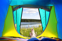 Tourist lying in his tent. Royalty Free Stock Photography
