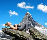 Tourist lying on a rock Royalty Free Stock Photo