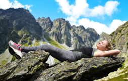 Tourist lying on a rock in Mengusovska Valley, Slovakia Stock Image