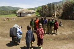 Tourist in Maasi Village, Ngorongoro Conservationa Area, Tanzani Stock Image