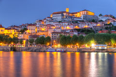 Tourist magnet Coimbra, Portugal. Old town of coimbra glows at night under a pretty summer sky, Portugal Royalty Free Stock Photos