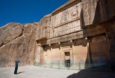 Tourist makes photo of historical landmark - the tomb of persian king Artaxerxes III in historical Persepolis, Iran. Royalty Free Stock Photo