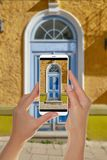 Tourist makes a photo of old blue wooden door royalty free stock photos