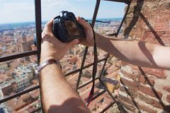 Tourist makes a travel photo from the top of Asinelli tower in Bologna, Italy. Royalty Free Stock Image