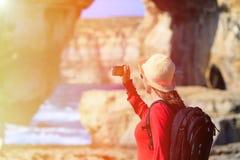 Tourist making photo of Azure Window in Gozo Stock Photo