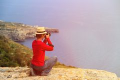 Tourist making photo of scenic view while travel Royalty Free Stock Photos
