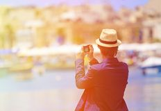 Tourist making photo of traditional boats in Royalty Free Stock Image