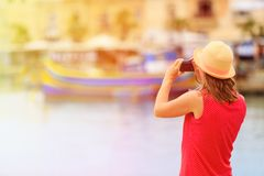Tourist making photo of traditional boats in Stock Image