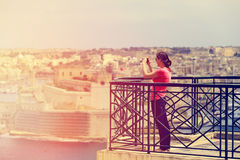 Tourist making photo of Valetta, Malta, travel concept Royalty Free Stock Photos