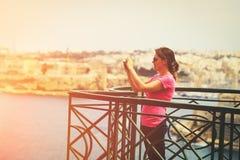Tourist making photo of Valetta, Malta, travel concept Stock Photo