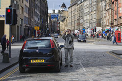 Tourist is making picture on the Royal Mile Royalty Free Stock Images