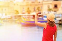 Tourist making selfie photo in Marsaxlokk, Malta Royalty Free Stock Images