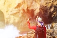 Tourist making selfie photo of scenic cliffs Royalty Free Stock Image