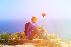 Tourist making selfie photo with stick on Royalty Free Stock Image