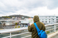 Tourist. Male tourist holding map and try to find the way in kumamoto city japan royalty free stock photos