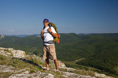 Tourist male looking on the sun and smilling Royalty Free Stock Images