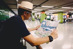 Tourist male with map. In metro in Kowloon, Hong Kong China Stock Image