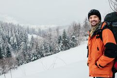 Smiling tourist winter mountain forest landscape stock image