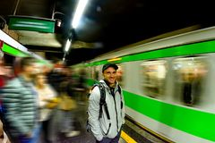 Tourist male is waiting for a train at the station in the underground Metro in Milan. Italy Royalty Free Stock Photos