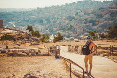 Tourist man with backpack visit historical place with gorgeous view surrounding city. Male Traveler Traveling On Summer Vacation e Stock Photos