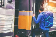 Tourist Man backpacker to travel at train station Stock Photography